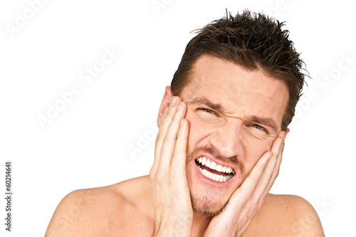 Young man holding your face because suffering from a toothache