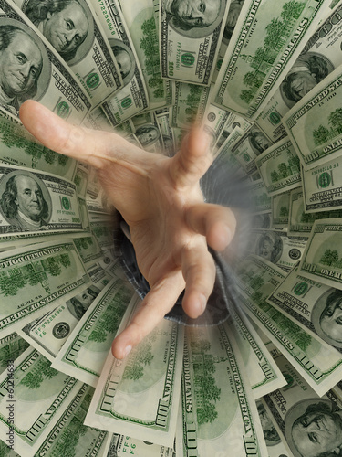 hand drowning in money hole