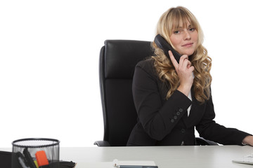 Friendly young businesswoman on the phone