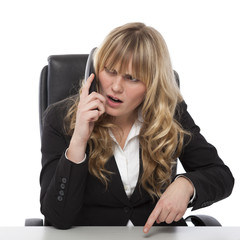 Puzzled businesswoman speaking on the phone