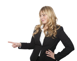 Businesswoman pointing to the left with a smile