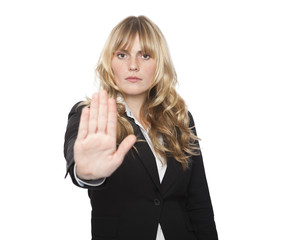 Stern businesswoman making a stop gesture