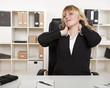 Overworked businesswoman stretching her neck