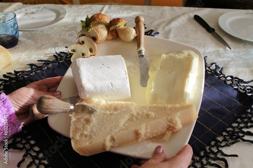 Mixed cheese plate with cutlery dedicated