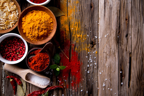 Assorted spices on wooden background - 60215848