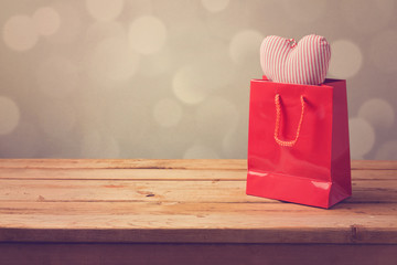 Valentine's day background with shopping bag and heart shape