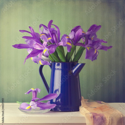 Iris flower bouquet over vintage background