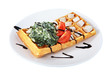 Belgian waffle with lettuce, cheese and tomato slices.