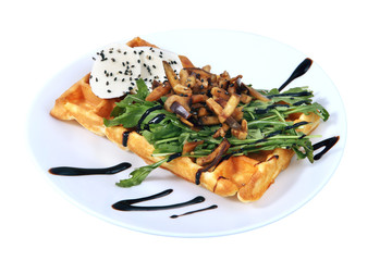 Belgian waffle with croutons, herbs and cheese isolated on white