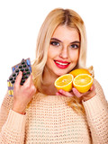 Woman having  tablets and lemon.