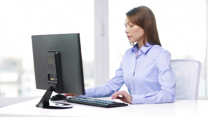 busy businesswoman with computer in office