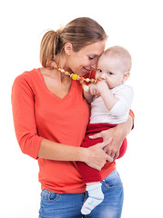 Young Caucasian woman and baby boy over white