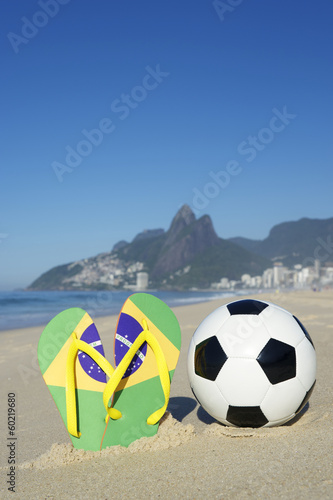 Soccer Ball Football and Flip Flops on Beach Rio Brazil