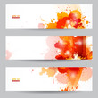 Three abstract artistic banners with orange dot paint splats