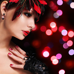 Fashion girl with feathers. Young woman with red lipstic