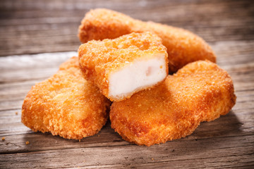 Nuggets on Wood Background