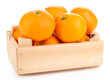 Ripe sweet tangerines in wooden box, isolated on white