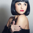 Retro Beautiful Brunette Girl. Healthy Black Hair. Retro Haircut