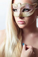Beautiful Blond Woman in Carnival Mask.Masquerade. Sexy Girl