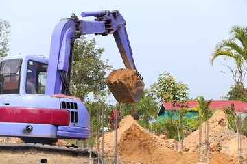 backhoe tractor works on a construction site