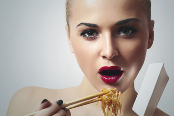 Beautiful Woman with Chinese Noodles.Red Lips.Enjoy meal