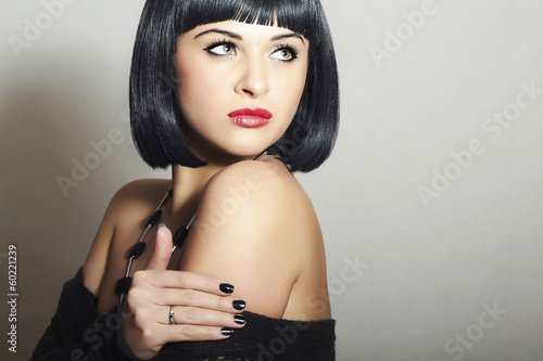 Retro Beautiful Brunette Woman. Healthy Black Hair.Red lips