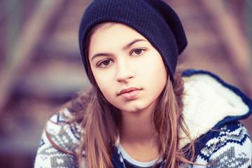 beauty teenage girl in hat outdoors