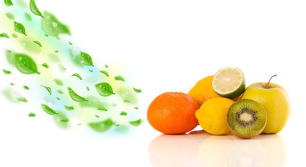 Colorful fruits with green organic leafs