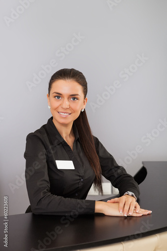 Office worker at reception.
