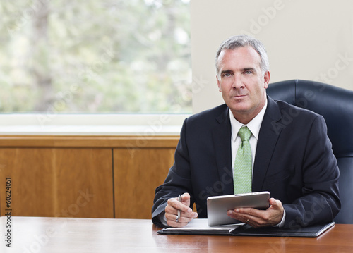Mature Businessman using tablet computer