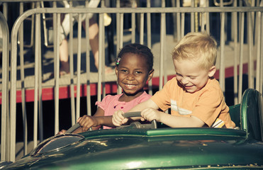 Kids on an amusement park ride