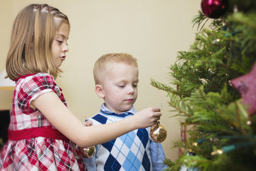 Kids decorating a Christmas Tree together