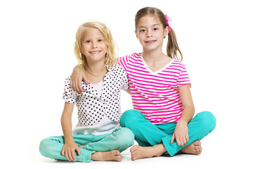 Two little girls who are best friends isolated on white