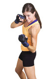 Fit and muscular woman boxing