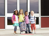 Fototapety Diverse group of kids going to school