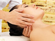 Woman having massage of neck in spa salon