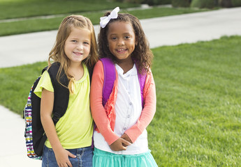 Cute Little girls walking to school together