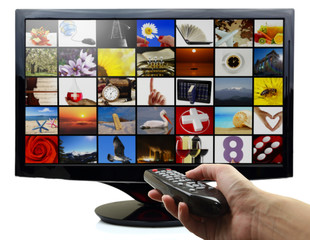 Smart tv with photos and hand holding remote control