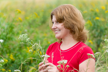 Middle-aged woman on a meadow