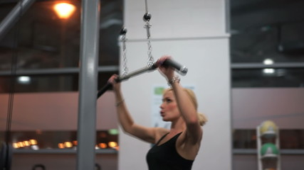 Young woman doing back exercises