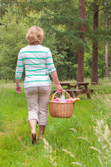 Woman carrying a picnic basket