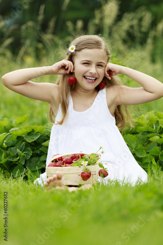 Strawberry - young girl with picked strawberries