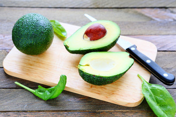 fresh avocado on a kitchen board