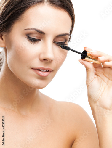 Young woman with cosmetics brush, isolated