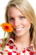 smiling young woman with a gerbera