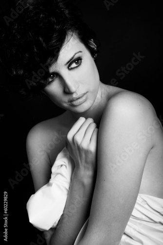Woman with intense look on black background © javiindy
