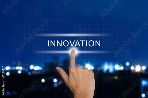 hand pushing innovation button on touch screen