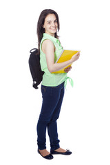 Full body portrait of a female student carring notebooks and bac