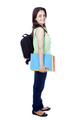 Side view of a female student carring notebooks and backpak, iso