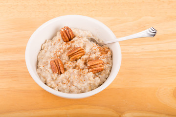 Cinnamon and Pecan Halves on Hot Oatmeal